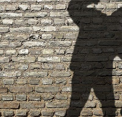 Shadow of a Man Beating Up Someone Else