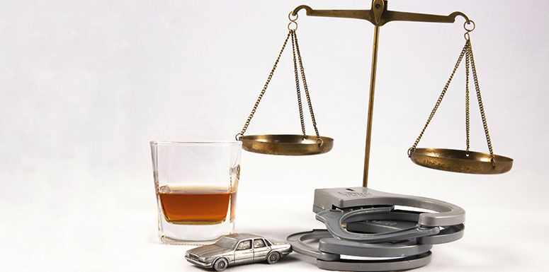 Scale, Drink, Handcuffs, and Car