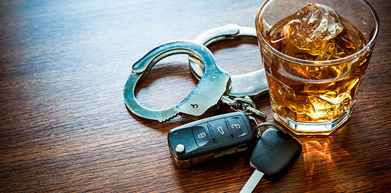 alcohol handcuffs and driving