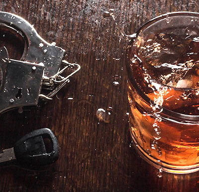 hand cuffs and alcohol